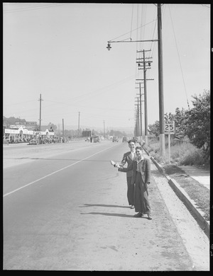 San Leandro, California. Hitch-Hiking. High school boys thumbing for a local ride to visit friends on a Saturday - NARA - 532091