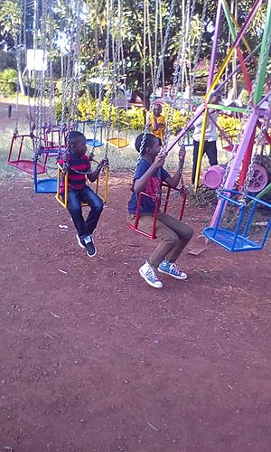 African kids playing on swings