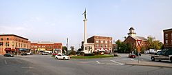 "Downtown Angola's traffic circle (or roundabout-- nicknamed ""The Mound""), looking east.  The monument in the center is dedicated to those who served in the American Civil War.  The building with the cupola is the Steuben County courthouse, which is on the National Register of Historic Places."