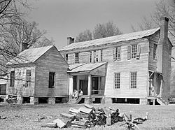 Rear view of the detached kitchen and former plantation home of the Mark Pettway family, called Sandyridge, in Boykin during April 1937. The house was demolished a short time later.  Photographed by Arthur Rothstein.