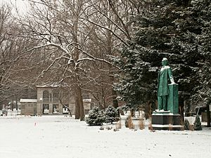 A snowy day in Carle Park west of the Urbana High School. On the right is a statue of Abraham Lincoln by Lorado Taft.