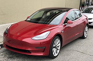 Tesla Model 3 parked, front driver side