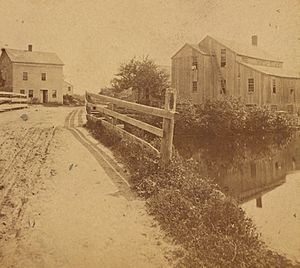 View of road next to body of water at Hopkinton, from Robert N. Dennis collection of stereoscopic views