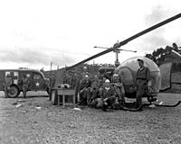 8225th MASH personnel with H-13 helo in Korea 1951