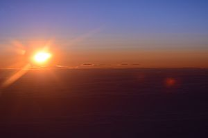 Sunset over the North Pole at the International Date line at 20,000 feet Aug 6th 2015 by D Ramey Logan