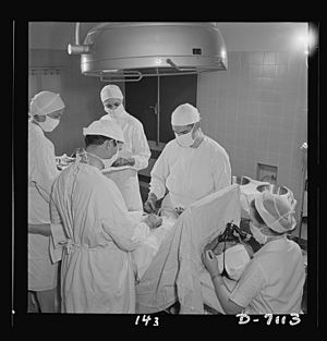 Young nurses assist at an appendectomy 8b07788v
