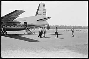 Charles Perkins greeted on tarmac at Inverell Airport, February 1965 - The Tribune (20103546323)