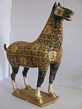 Tang Dynasty-Blue spotted 'leopard' horse. Body cladded in gilded filigree