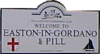 Street sign with the words Welcome to Easton in Gordano & Pill.