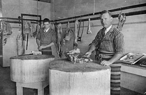 StateLibQld 2 179199 Claude Burton in his butcher shop in Wondai, Queensland, 1935