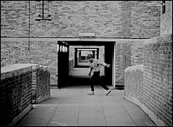 Young man running on the North Peckham Estate