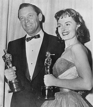 William Holden and Donna Reed hold their gold-plated Oscars, 1954