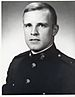 A black and white image of Graves wearing his Marine Corps dress blue uniform without his hat.