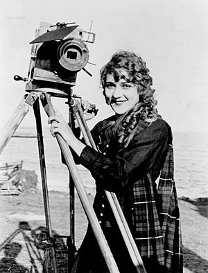 Mary Pickford on Beach with Camera, ca. 1916 (LOC)