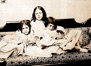 Alice Liddell with sisters