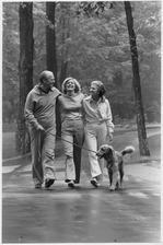 Photograph of President Gerald Ford and First Lady Betty Ford Walking with Their Daughter Susan and Their Dog... - NARA - 186835