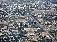 Aerial view of central Orange County overlooking South Coast Metro, John Wayne Airport, and the Irvine business district
