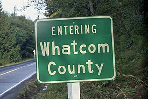 Entering-Whatcom-County sign at county line in Washington, 1970