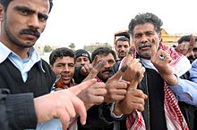 Iraqi voters inked fingers