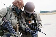 Norwegian soldiers w respirators and radio