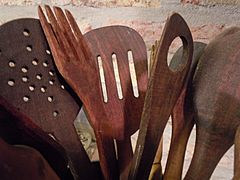 Wooden spoons and other utensils for frying.