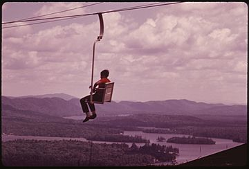 MCCAULEY MOUNTAIN, NEW YORK, CHAIR LIFT GIVES TOURISTS A PANORAMIC VIEW IN THE ADIRONDACK FOREST PRESERVE - NARA - 554490.jpg