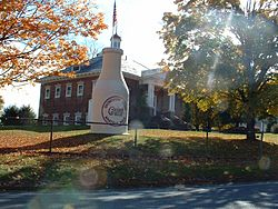 "The ""Whately Milk Bottle"" in front of the old Whately Central School"
