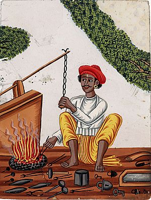 A blacksmith in front of his fire with one hand on a chain attached to the bellows