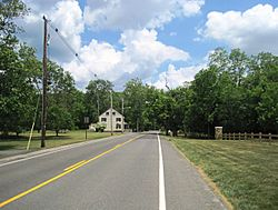 Approaching the center of Arneytown on eastbound CR 664
