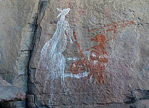 Rock painting of a hunter with a Kangaroo