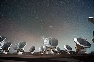 The Atacama Large Millimeter submillimeter Array (ALMA) by night under the Magellanic Clouds