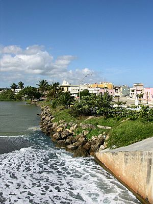 Downtown Arecibo as seen from the mouth of the Río Grande de Arecibo in 2006.