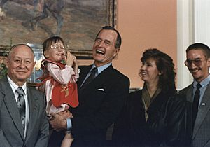 President George H.W. Bush holds Jessica McClure in the Roosevelt Room at the White House (1989-07-19)