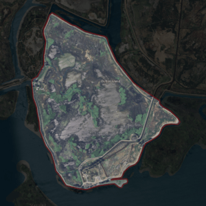 Aerial photo of a sad island surrounded by muck.