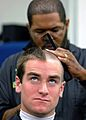 US Navy 090701-N-8395K-001 A plebe receives his first Navy haircut during Induction Day at the U.S. Naval Academy