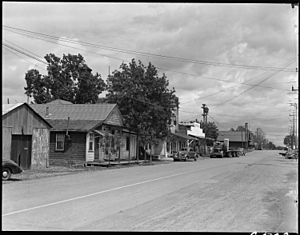Florin, California. Main Street of this small town in the center of the strawberry and grape- produ . . . - NARA - 537883