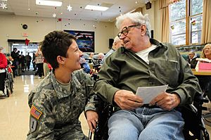 Defense.gov News Photo 101215-F-0681L-2552 - U.S. Army Staff Sgt. Amy Wieser Willson left with the 231st Brigade Support Battalion North Dakota National Guard visits with a resident of the