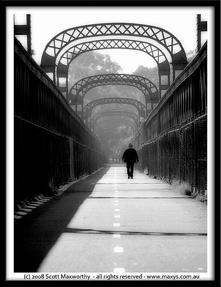 Man walking across como bridge.jpg