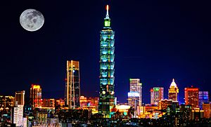 Taipei skyline cityscape at night with full moon