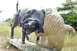 Sculpture of a battle between a buffalo and a lion
