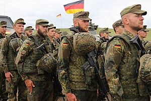 German army soldiers stand at attention for the Georgian natinal anthem during Noble Partner 18 at Vaziani Training Area, Georgia.jpg