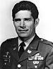 A black and white image showing the head and shoulders of Rocco in his military dress uniform with ribbons.