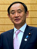 Yoshihide Suga cropped 3 Joint Press Announcement of the Okinawa Consolidation Plan