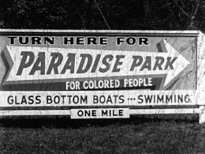 Billboard and direction for Paradise Park, Florida