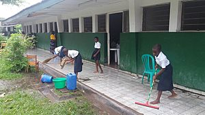 Children cleaning their classrooms
