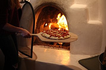 Pizza baking in Wood-fired oven