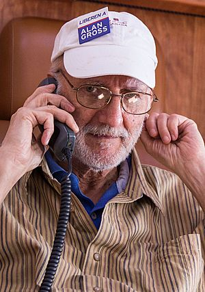 Alan Gross talking on the phone