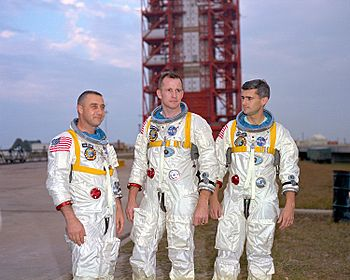 Grissom, White, and Chaffee in front of the launch pad containing their AS-204 space vehicle