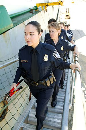 CBP female officers going aboard a ship