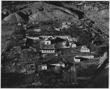 Taos County, New Mexico. View of Valdez. Note layout of houses in square around the church, a styl . . . - NARA - 521935